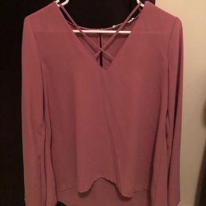 Long sleeve lush top. Criss cross on chest
